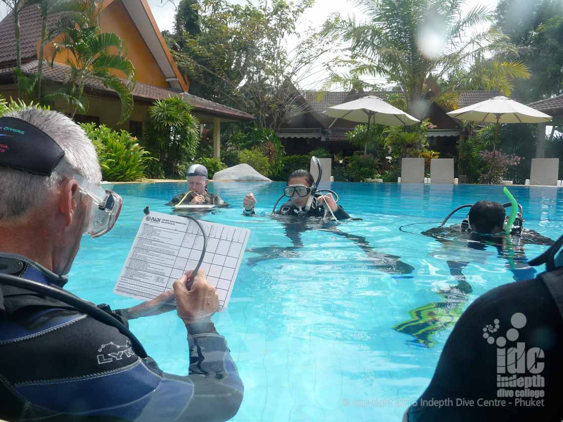 PADI IDC Staff candidate grading a Confined Water Teaching presentation next to his Course Director at Indepth Dive Centre Phuket
