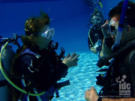 PADI Open Water Scuba Instructor (OWSI) with Candidates in the pool on Phuket