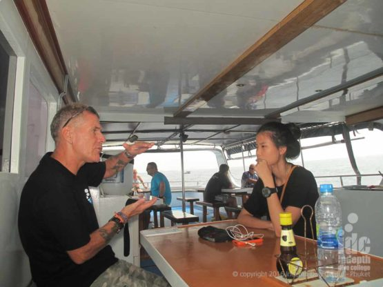 PADI Underwater Navigation Dive briefing on the boat before the first dive