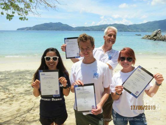 New PADI instructors show their certificates