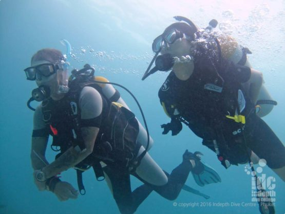 PADI ScubaDiver Instructor diving with his student