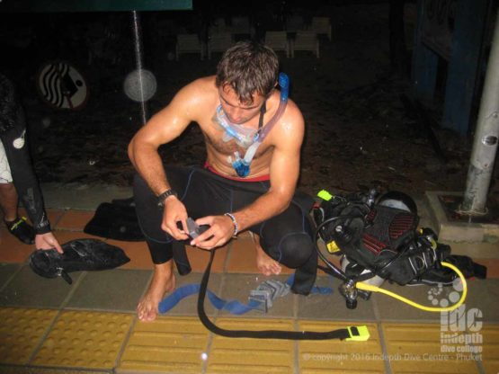 PADI Night Diver student getting ready for Phuket beach Night dive