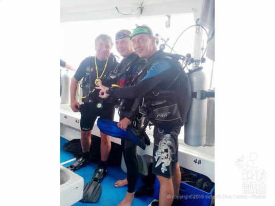 PADI Drift Divers getting ready to enter water off the back of the boat