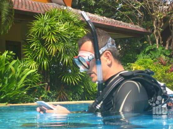 Scuba Instructor Candidate giving a briefing on the Skill his students will perform