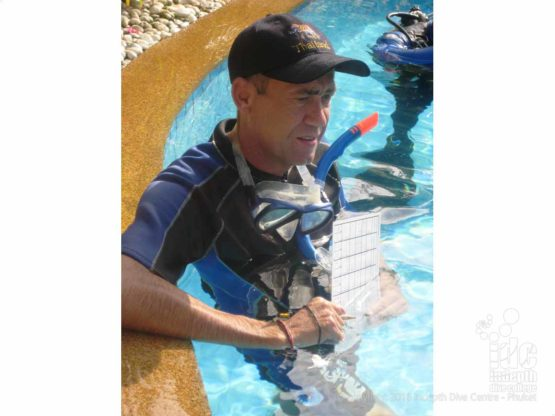 Chris Owen, Indepth Dive Centre PADI Course Director, grading IDC presentations in the pool