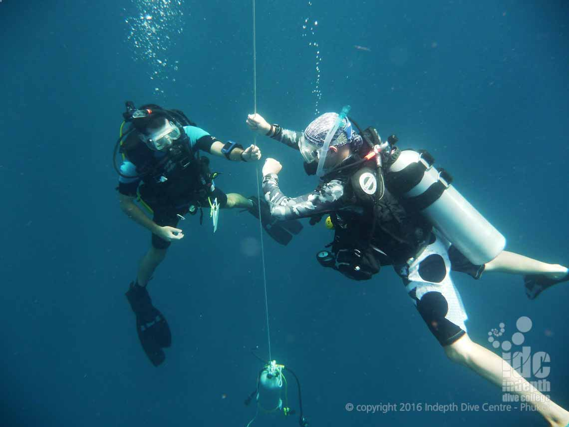 Thailand PADI Divemaster Course on Phuket: Divemaster doing a Safety Stop after a PADI Deep Diver Specialty Course Dive