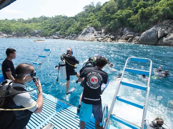 Phuket Dive Trip Boat 1: PADI Scuba Divers entering the water at Racha Noi