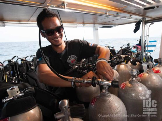 Phuket Dive Trip Boat 1: happy staff filling tanks during the surface interval on Boat 1 at Racha Yai