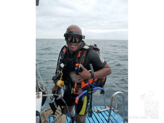 Fun Adventure diver on the boat at Koh Doc Mai Phuket