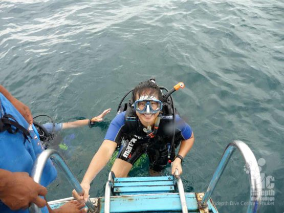 Happy PADI Nitrox diver getting back on the boat