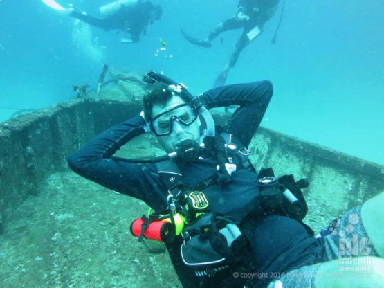 Happy diver laying in his hammock on the wreck