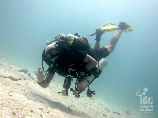 A Poseidon Rebreather diver diving with Indepth Dive Centre and enjoying himself at Homerun Reef