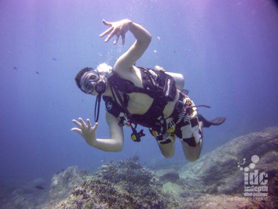 Happy diver at Homerun Reef dive site Racha Yai Island