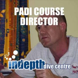 Our PADI Course Director Chris Owen listening to a classroom teaching presentation