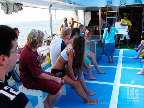 PADI Divemaster diving the Dive Site briefing on a Phuket Day Trip