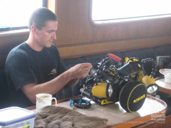 Digital Underwater Instructor on his PADI Master Scuba Diver Trainer assembling one of his cameras
