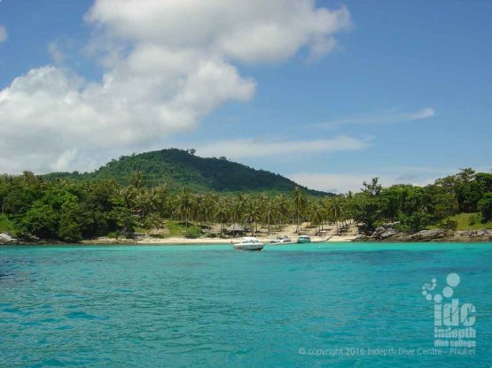 Scenic shot of Racha Yai Bay 1 taken from a Dive Boat