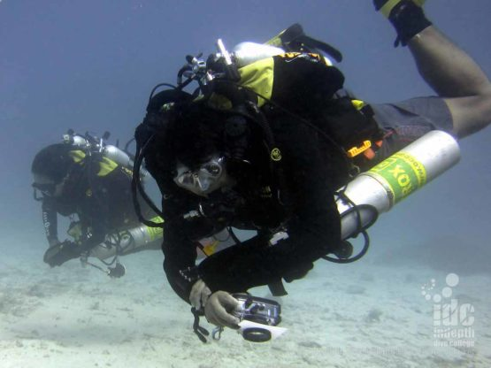 PADI Underwater Photo Course student having an awesome time on his Poseidon Rebreather