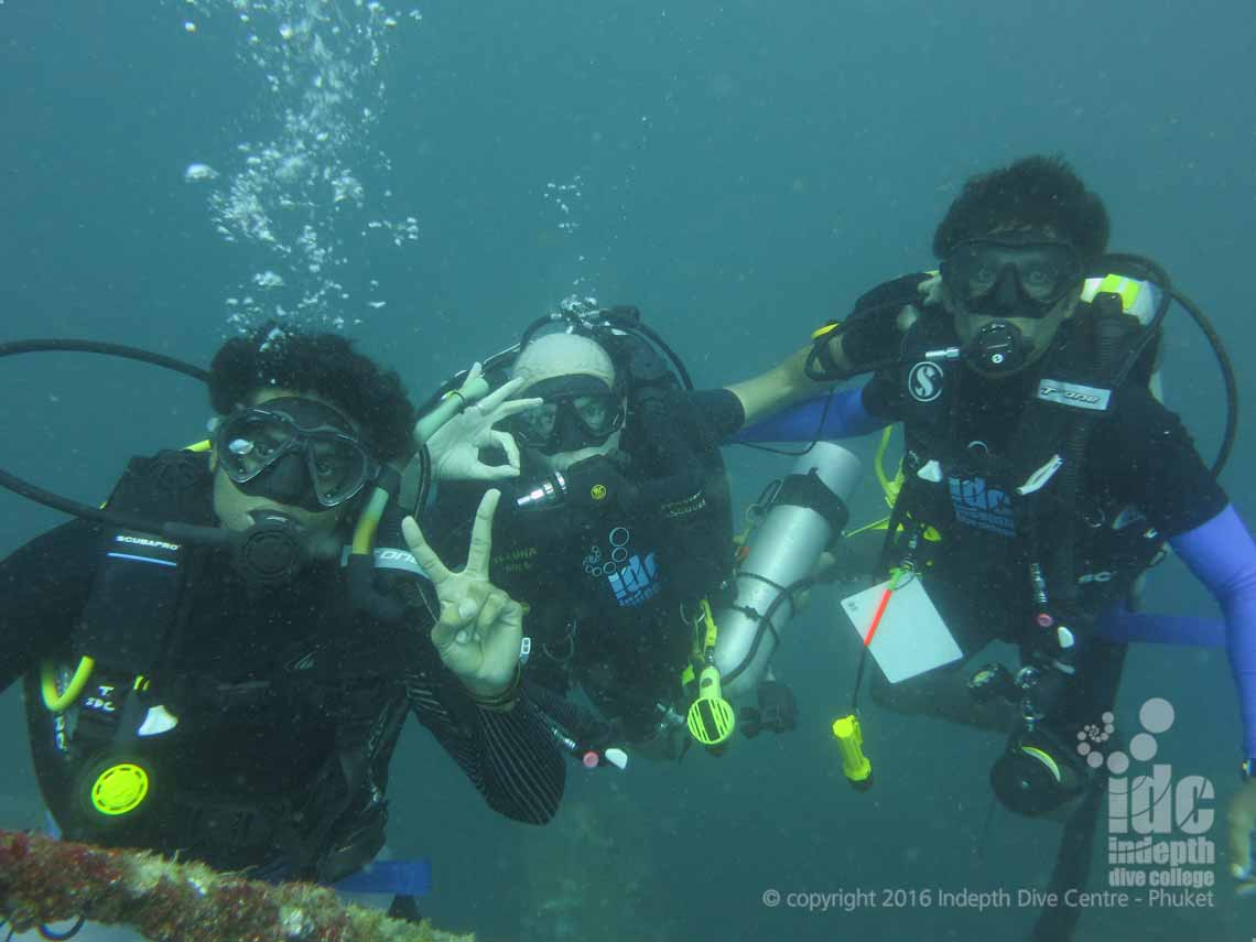 Poseidon Se7en Rebreather diver and buddies on their PADI Master Scuba Diver final dive