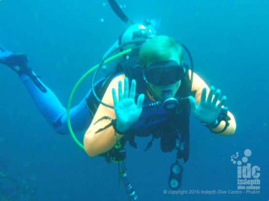 Scuba Diver fun with Indepth Dive Centre at Black Rock