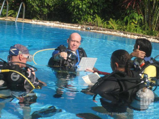 IDC Staff receive feedback from the PADI Course Director