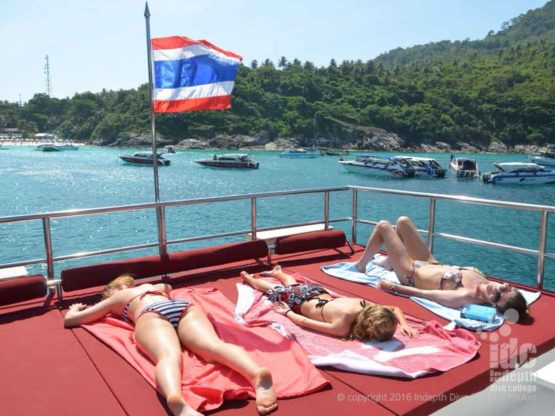 Sunbathing on Indepth Dive Centre Phuket Diving day Trip Boat 4
