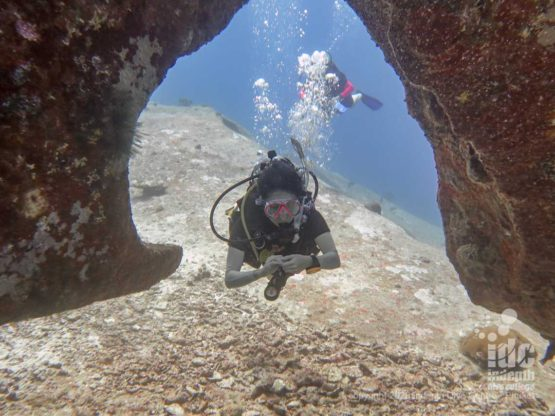 Swimthrough under the boulders of Christmas Point Dive Site