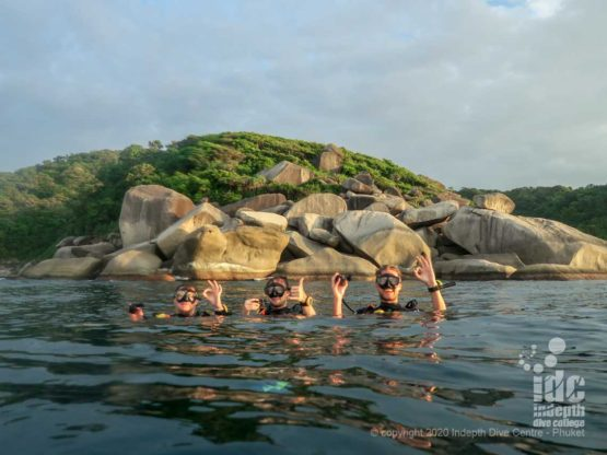 Turtle Rock on the surface with happy divers- Similan islands Dive Site