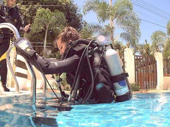 Entering the water for the first time with her Poseidon MKVI Rebreather