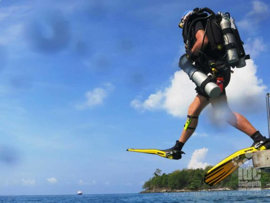 Giant stride of the boat on a PADI Rebreather Diver Course on Phuket Island