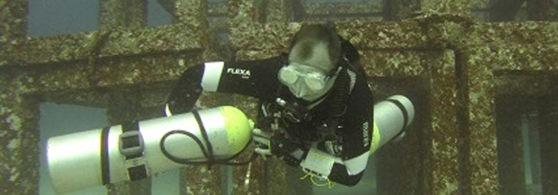 Ben Capitaine demonstrating PADI Sidemount Skills at the Cubes in Racha Yai Bay 1