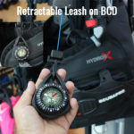 Retractable diving compass attached to BCD